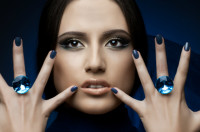 Image of a woman with diamond rings